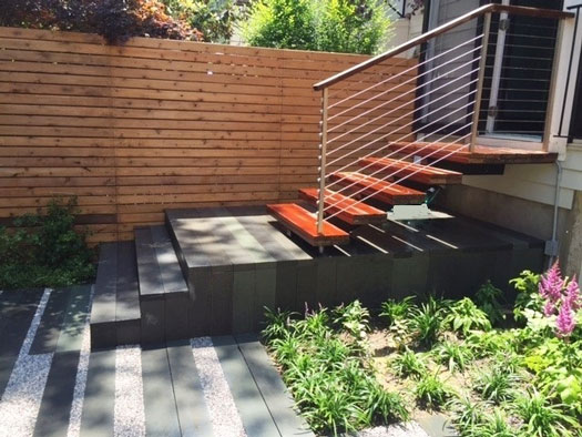 Fence and stairway in modern urban backyard landscape